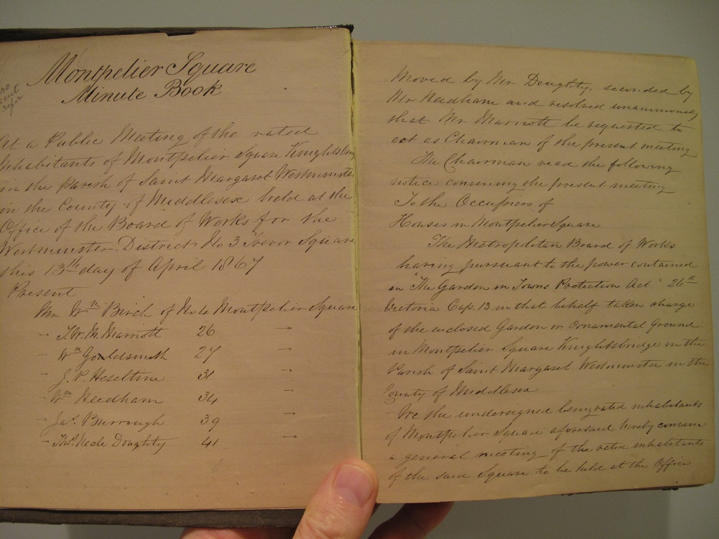 Photograph of first page of old minutes book (Click to enlarge)